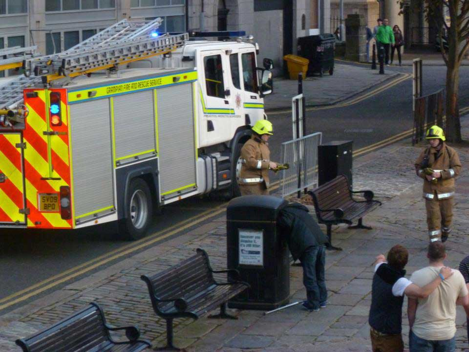 Man with head stuck in bin Castle Street, Aberdeen