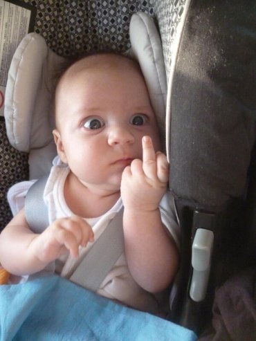 baby giving finger