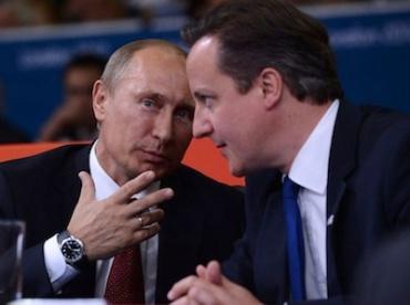 Russia's President Vladimir Putin (L) and British Prime Minister
