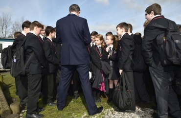 david cameron with school children