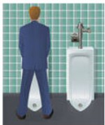 man peeing at urinal